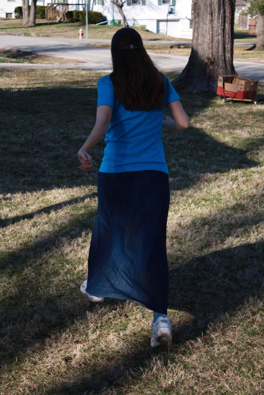Playing Kickball in skirt