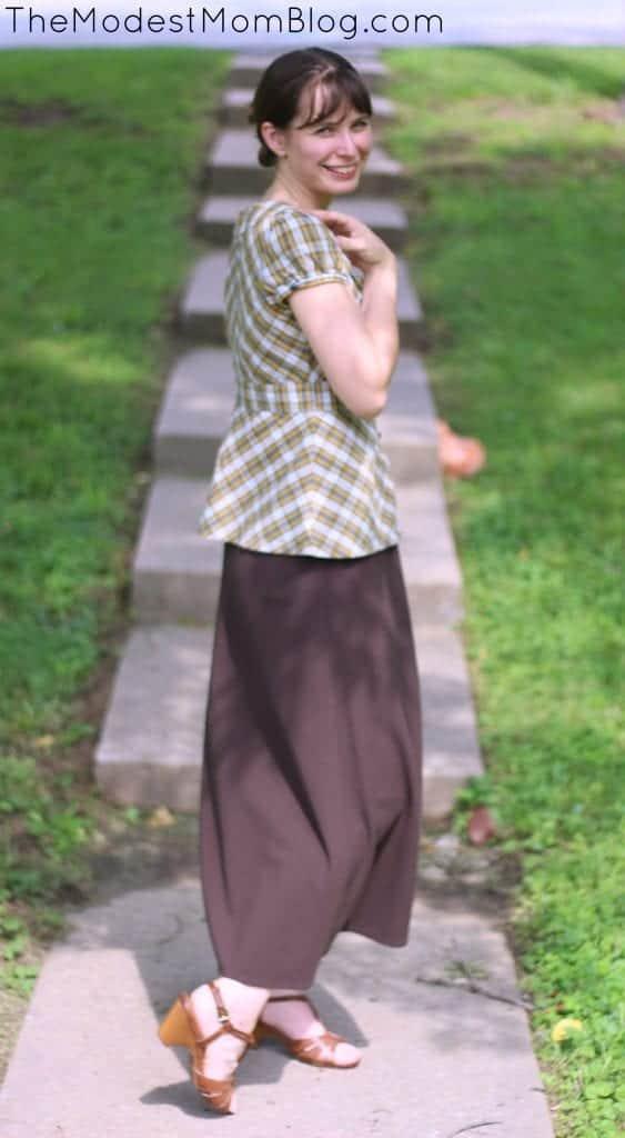 Brown skirt and plaid shirt