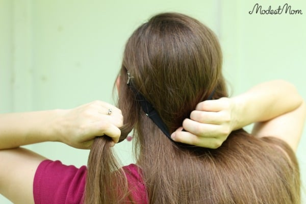 Start twisting your hair around the headband in the back!