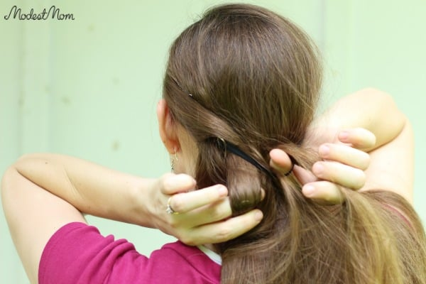 Twist your hair around the headband
