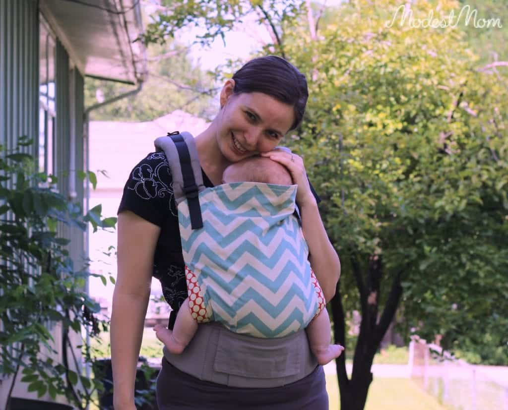 Snuggling with my baby in a Tula baby carrier!