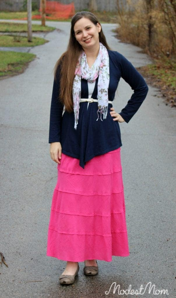 Pink skirt, navy blue cardigan with a lace cami and pearl skinny belt!