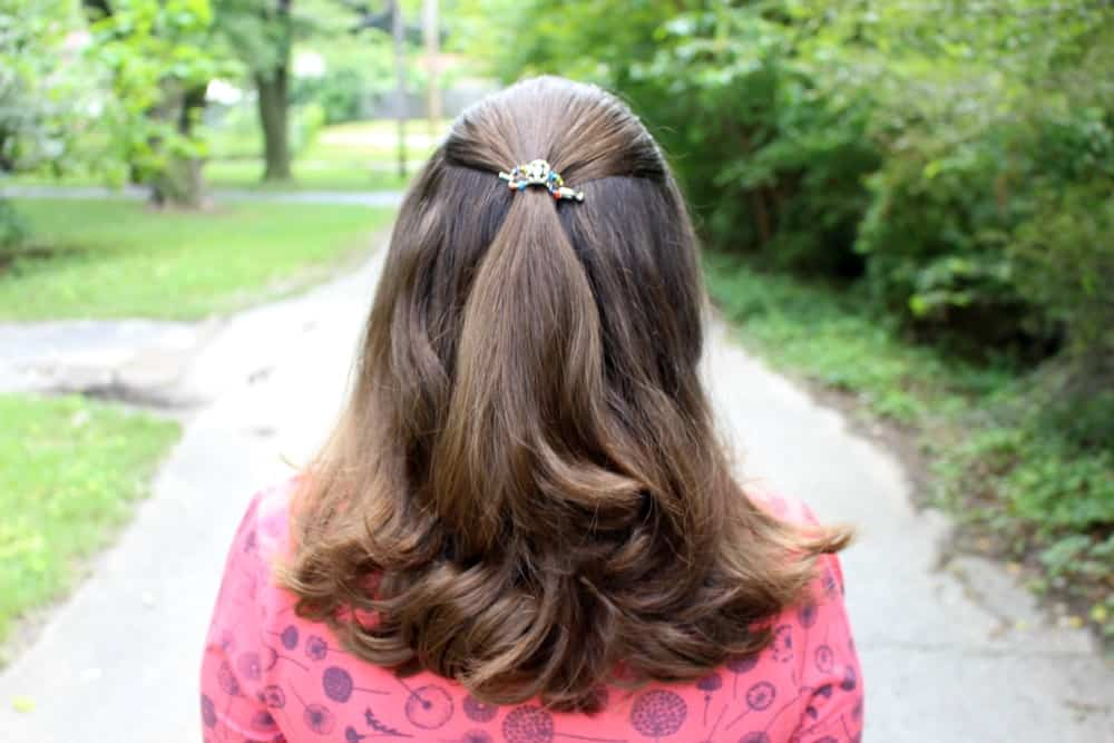 Curly hair with a Mini Lilla Rose Flexi Clip. They work so great for holding hair back, and are pretty!