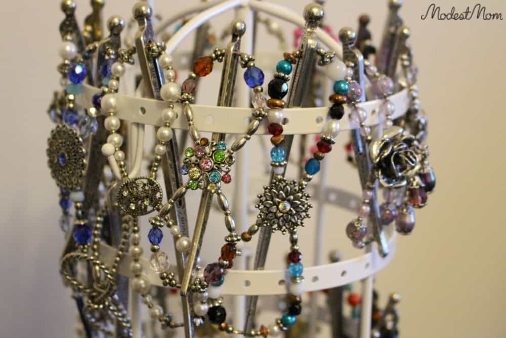 Large Flexi Clips on a jewelry holder to organize them.