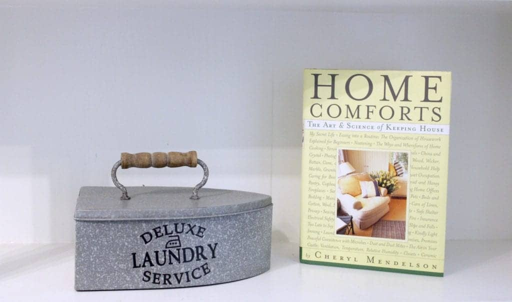 Laundry Room Makeover. Vintage iron tin container to hold dryer balls, and a Home Comforts Book.