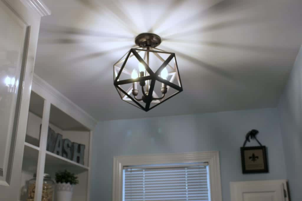 Laundry Room Makeover with this light from Lowes.