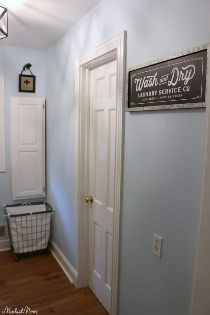 Our small laundry room makeover! From wallpaper to paint, and open shelving, this laundry room is now practical and beautiful!