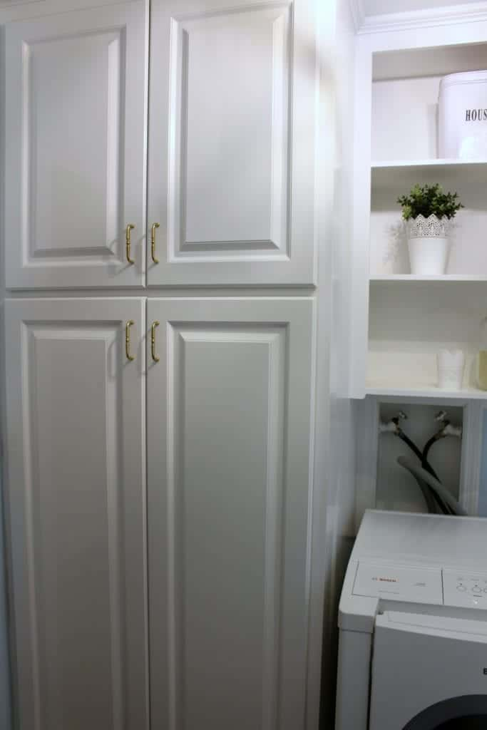 Setting up a family closet in the laundry room.